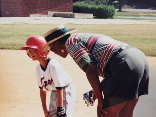 Brett Gordon being coached by Ernie Banks at his little league game.