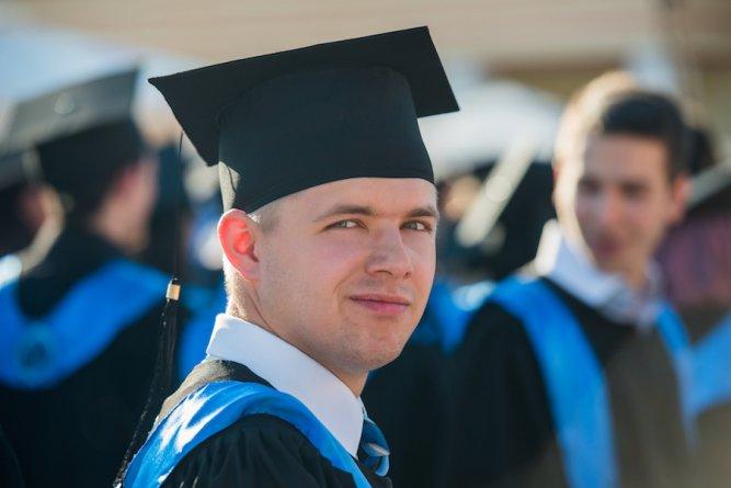 Male graduate student with graduation cap