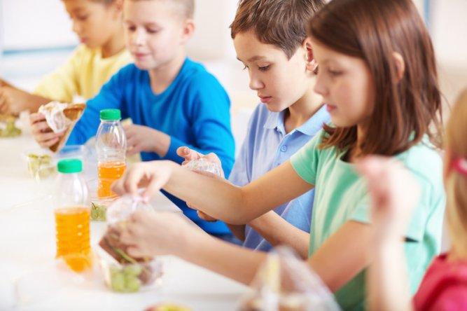 Group of classmates having lunch during break